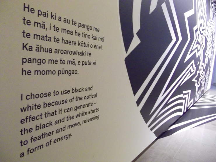English and Mauri text beside graphic wall art at Auckland Art Gallery