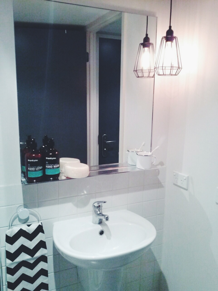 911/268 Flinder Street Melbourne bathroom sink pendant wire cage light view studio apartment