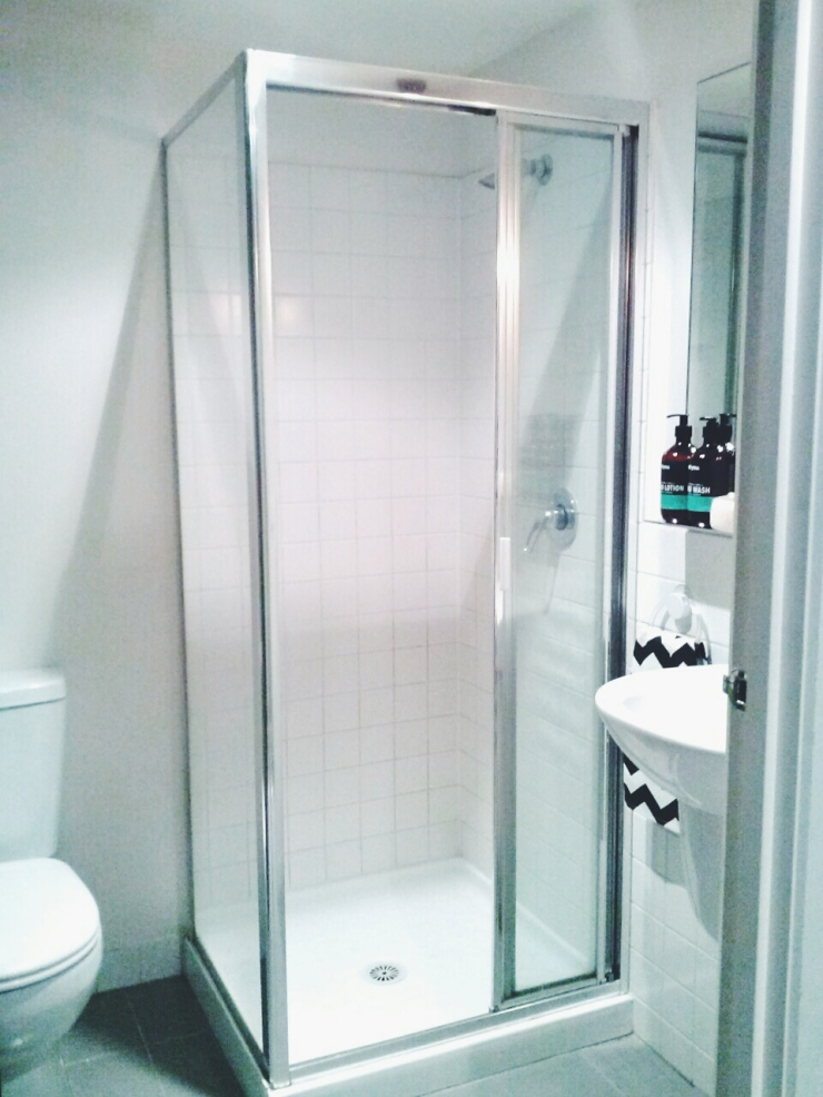 911/268 Flinder Street Melbourne shower bathroom toilet view studio apartment