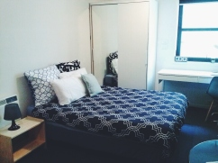 Bed wardrobe view Unit 911 268 Flinders Street Home@Flinders Melbourne Studio by Ideas Dispenser