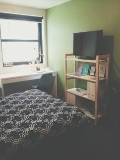 Bed desk chair shelf window view Unit 911 268 Flinders Street Home@Flinders Melbourne Studio by Ideas Dispenser