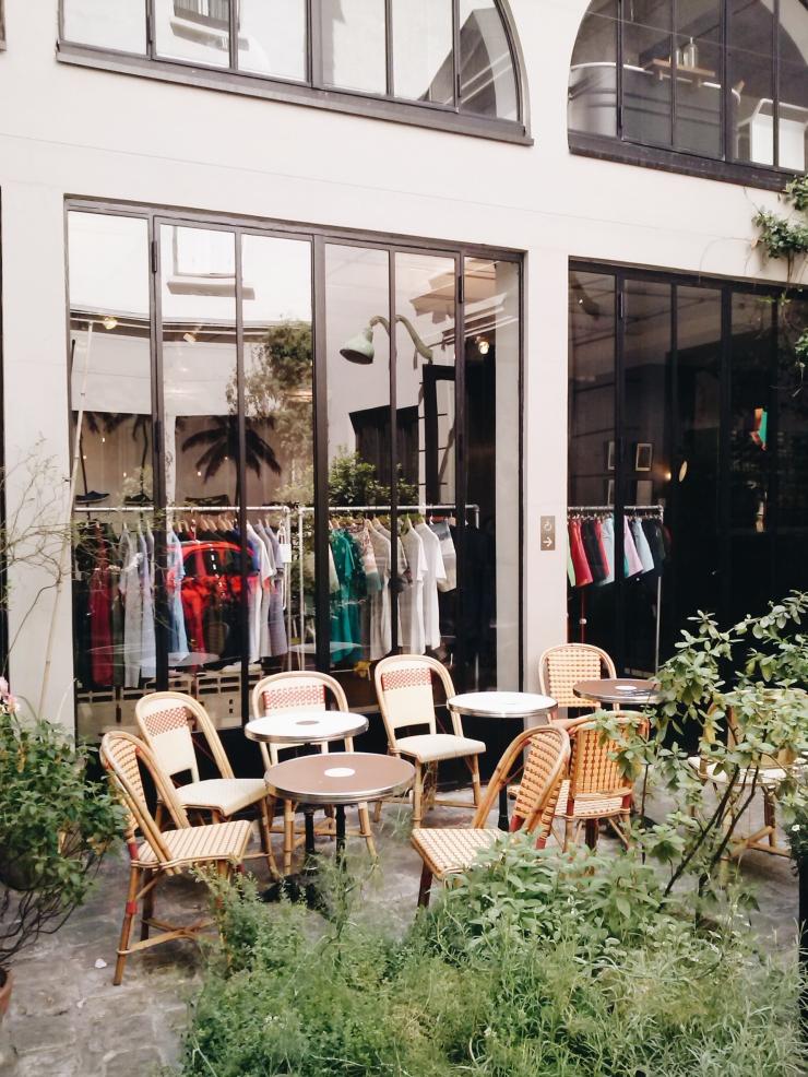 Merci Paris inner courtyard rattan seating