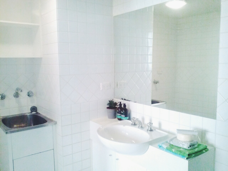 Henty House Unit 107 501 Little Collins Street Melbourne bathroom and laundry view