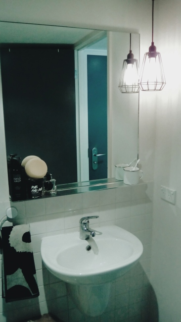 Unit 911 268 Flinders Street Home@Flinders Melbourne Studio by Ideas Dispenser 2016 bathroom mirror view