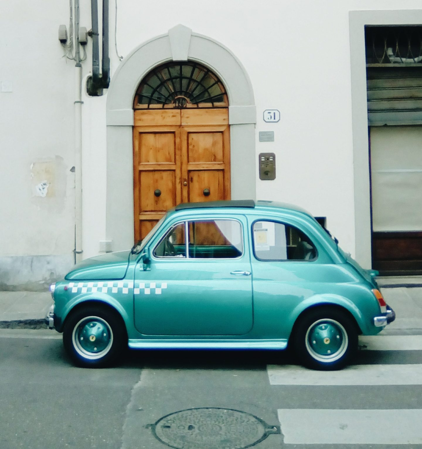Green vintage Fiat500 in Florence Firenze