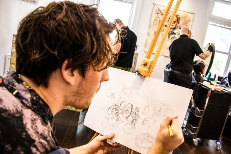 Artist Brendan Hartnett at Rakis on Collins painting event in salon LIVE sketch